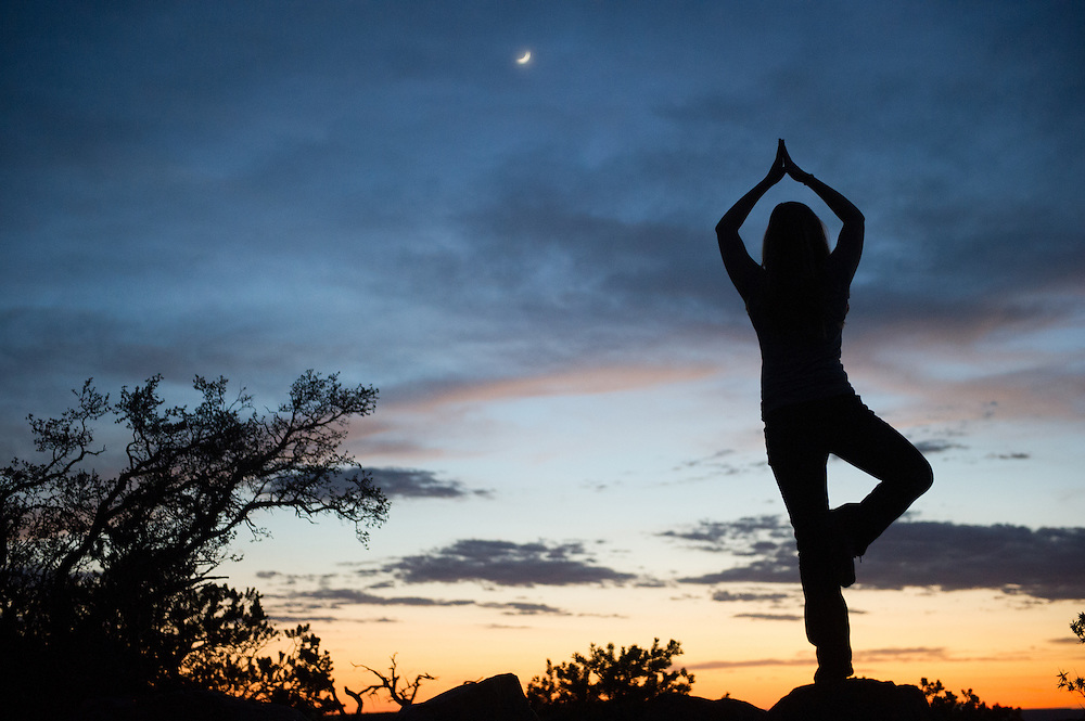 Woman Doing Yoga Pose at Grand Canyon Sunset