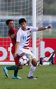 Team USA forward Rafael Jauregui (11) intercepts a pass to Portugal forward Joao Faria (6) during a CONCACAF boys under-15 championship soccer game, Saturday, August 10, 2019, in Bradenton, Fla. Portugal defeated Team USA 3-0 and advanced to the finals against Slovenia. (Kim Hukari/Image of Sport)