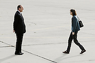 French President Jacques Chirac welcomes back Florence Aubenas, a French journalist who was released after being held hostage for six months in Irak, as she steps out of the plane. Villacoublay airport, west of Paris, 12 June 2005.