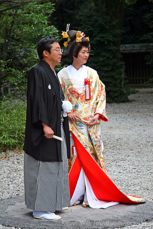 Asia, Japan, Tokyo. Bride and Groom in traditional Japanese wedding dress.