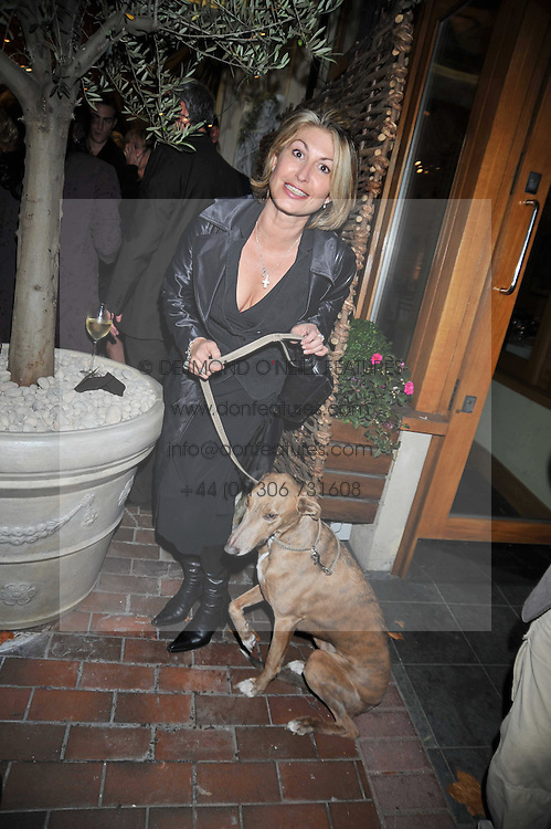 MATI WHITE former wife of Marco Pierre White and her dog Pluto at the opening party for the new Gail Berry emporium at 187 New Kings Road, London SW6 on 30th September 2009.<br /> <br /> <br /> <br /> BYLINE MUST READ: donfeatures.com<br /> <br /> *THIS IMAGE IS STRICTLY FOR PAPER, MAGAZINE AND TV USE ONLY - NO WEB ALLOWED USAGE UNLESS PREVIOUSLY AGREED. PLEASE TELEPHONE 07092 235465 FOR THE UK OFFICE.*