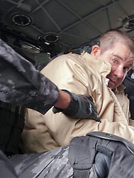 Jan. 19, 2017 - Ciudad Juarez, Mexico - Image provided by the Attorney General of the Republic (PGR) of Mexico shows drug lord JOAQUIN GUZMAN LOERA, alias ''El Chapo'', during his transfer from the Federal Center for Social Readaptation to the airport of Ciudad Juarez. The Mexican government announced on Jan. 19, 2017 that Joaquin Guzman Loera was being extradited to the U.S. (Credit Image: © PGR/Xinhua via ZUMA Wire)