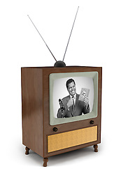 1950's era TV with black and white commercial showing a man pitching a product