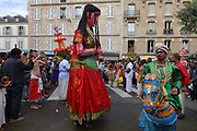 Colourful costumes in the parade celebrating the festival of Ganesh Chaturthi, marking the birth of the Hindu god Ganesha, on the streets of the La Chapelle area of the 18th arrondissement of Paris, France, on Sunday 1st September 2019. The annual religious festivities and parade take place near the Ganesha Temple of Paris, or Sri Manicka Vinayakar Alayam Temple, the largest Hindu temple in France. Ganesha is the elephant-headed Hindu God of Beginnings, son of Shiva and Parvati, who represents love and knowledge. Picture by Manuel Cohen