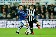 Javier Manquillo (#19) of Newcastle United holds off the challenge from Aaron Lennon (#12) of Everton during the Premier League match between Newcastle United and Everton at St. James's Park, Newcastle, England on 13 December 2017. Photo by Craig Doyle.