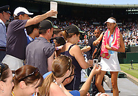 Russian Teenager Maria Sharapova signs autographes for fans after her victory over Jelena Dokic. Wimbledon Tennis Championship, Day 6, 28/06/2003. Credit: Colorsport / Matthew Impey DIGITAL FILE ONLY