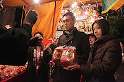 Japanese couple buying a Daruma at a Torino no Ichi fair