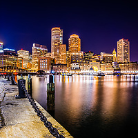 Boston skyline at night picture. Includes the Boston Harborwalk waterfront, downtown Boston skyscrapers and Nothern Avenue Bridge.