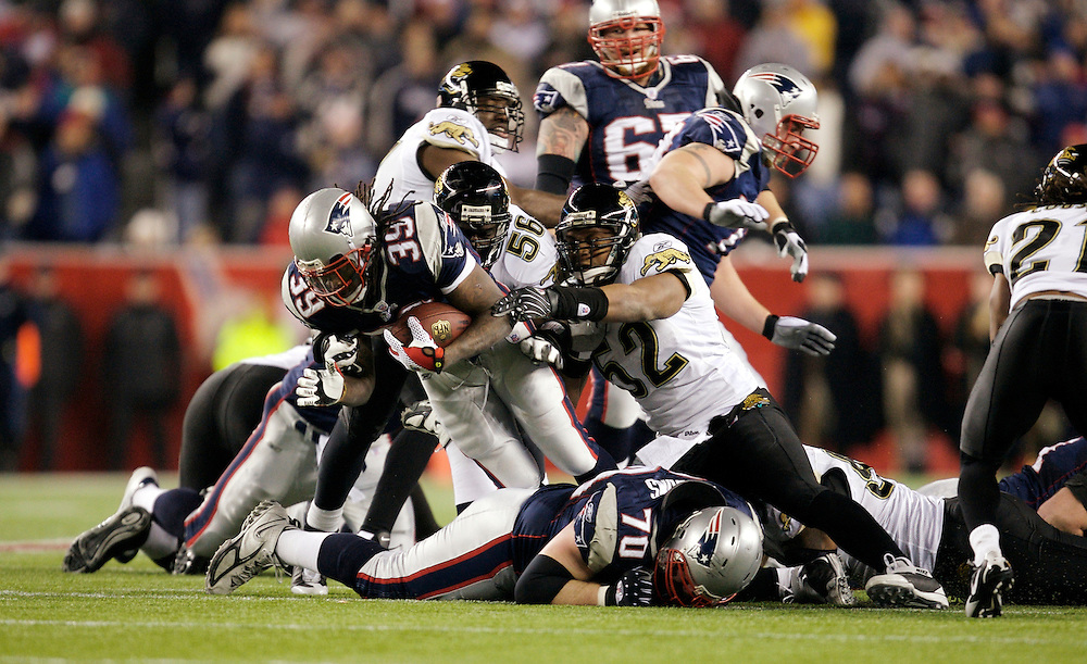 FOXBORO, MA - JANUARY 12: Laurence Maroney #39 of the New England Patriots is tackled by the Jacksonville Jaguars defense during the AFC Divisional Playoff game played on January 12, 2008 at Gillette Stadium in Foxboro, Massachusetts. The Patriots defeated the Jaguars 31 to 20