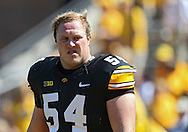 September 15 2012: Iowa Hawkeyes defensive lineman Steve Bigach (54) warms up with the team before the start of the NCAA football game between the Northern Iowa Panthers and the Iowa Hawkeyes at Kinnick Stadium in Iowa City, Iowa on Saturday September 15, 2012. Iowa defeated Northern Iowa 27-16.