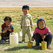 Kyrgyz children collecting water, Pamir plateau