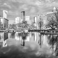 Charlotte skyline black and white photo with downtown Charlotte city reflection on Marshall Park pond, Duke Energy Center and One Wells Fargo Center buildings. Charlotte, North Carolina is a major city in the Eastern United States of America.