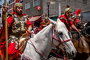 Actors playing Roman cavalry ride through the streets of Iztapalapa. Most of the horses for the annual event are on loan from the Mexico City police force. Despite being well trained, there are horse-related accidents nearly every year.