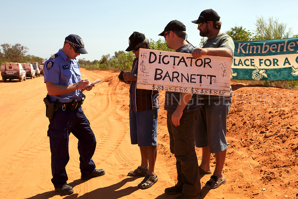 Police giving fines to protesters celebrating the 100th day of the No Gas Protest at the Manari Road Community Camp in Broome, WA
