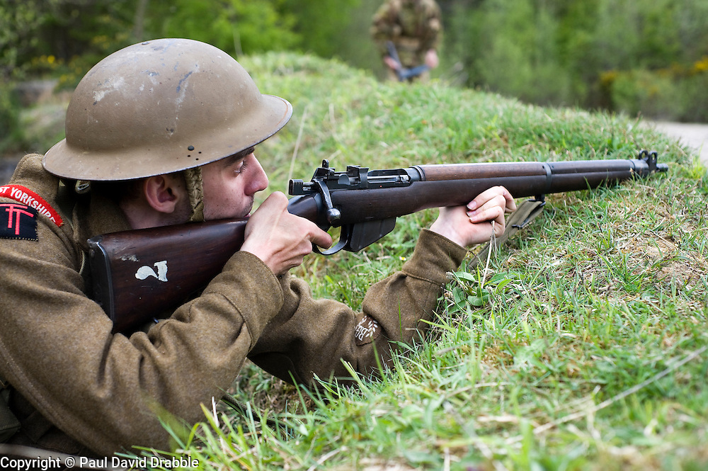 Reenactor from Northern World War Two Association, portraying the 5th Battalion, East Yorkshire, waits to ambush German troops during a private 24hr excerise.<br /> Sutton Grange, near Ripon Yorkshire 15  May 2010. Images &copy; Paul David Drabble.