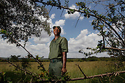 Field ranger Amos poses for a photo after attending a training courese with Nkwe wildlife security serviceswho  offer a paramilitary - style rhino protection service that operates in the several private game reserves in the Limpopo area of South Africa.Nkwe's recruits undergo a basic two week training program focusing on military discipline and endurance to become a field ranger. From this stage the field rangers may be selected for an advance course that focuses on firearms and tactical training. Once this is completed they will be given rank and go on armed patrol to protect the rhinos...Pic shows: Nkwe Wildlife Security Services based in the Lapalala Wilderness Area, Limpopo, South Africa...© Zute Lightfoot