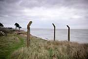 © Licensed to London News Pictures. 22/10/2017. Bawdsey, UK. Broken fencing. RAF Bawdsey, WW2 radar and Cold-War Bloodhound Surface to Air Missile (SAM) base at Bawdsey Ferry, Suffolk, today 22nd October 2017. The base was decommissioned in 1991 leaving behind a deserted base.  Photo credit: Stephen Simpson/LNP