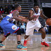 Delaware 87ers Guard Maalik Wayns (12) arm checks Grand Rapids Drive Forward Adonis Thomas (14) in the second half of a NBA D-league regular season basketball game between the Delaware 87ers and the Grand Rapids Drive (Detroit Pistons) Saturday, Apr. 04, 2015 at The Bob Carpenter Sports Convocation Center in Newark, DEL.