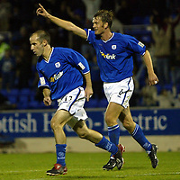 St Johnstone v Hamilton Accies....23.09.03  CIS Cup<br />Brian McLaughlin celebrates his last gasp equaliser with Ian Maxwell<br /><br />Picture by Graeme Hart<br />Perthshire Picture Agency<br />Tel: 01738 623350 / 07990 594431
