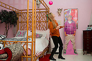 Haley Berg, 15, plays with a mini soccer ball in her bedroom in Celina, Texas on January 23, 2014. Berg, a freshman at Celina High School, began receiving attention from top collegiate soccer programs when she was 13 and has already committed to the University of Texas. (Cooper Neill / for The New York Times)