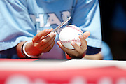 ANAHEIM, CA - JULY 21:  A fan holds a baseball as he waits for an autograph before the Los Angeles Angels of Anaheim of Anaheim game against the Texas Rangers on Saturday, July 21, 2012 at Angel Stadium in Anaheim, California. The Rangers won the game 9-2. (Photo by Paul Spinelli/MLB Photos via Getty Images)