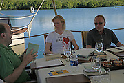 Mark Lawson, Tilda swinton and Tim Lott, Judges meeting on the floating restaurant. Preparing for the Le Prince Maurice Prize. Mauritius. 27 May 2006. ONE TIME USE ONLY - DO NOT ARCHIVE  © Copyright Photograph by Dafydd Jones 66 Stockwell Park Rd. London SW9 0DA Tel 020 7733 0108 www.dafjones.com