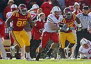 November 06 2010: Nebraska Cornhuskers running back Rex Burkhead (22) tries to avoid the Iowa State Cyclones defenders during the first half of the NCAA football game between the Nebraska Cornhuskers and the Iowa State Cyclones at Jack Trice Stadium in Ames, Iowa on Saturday November 6, 2010. Nebraska defeated Iowa State 31-30.