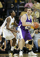 15 FEBRUARY 2007: Northwestern center Ivan Tolic (42) looks for an open player to pass to while being guarded by Iowa forward Kurt Looby (52) in Iowa's 66-58 win over Northwestern at Carver-Hawkeye Arena in Iowa City, Iowa on February 15, 2007.