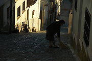 Woman sweeping the street early in the morning, Sucre, Bolivia