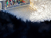 Aerial of airboat looking straight down.  Spray filling most of frame