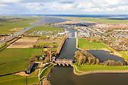 Nederland, Friesland, Gemeente Lemsterland, 16-04-2012; Lemmer, ir. D.F. Woudagemaal. In de achtergrond de jachthaven, recreatiewoningen en caravanpark. . Het stoomgemaal staat op de Unesco Werelderfgoedlijst en is het grootste nog in bedrijf zijnde stoomgemaal ter wereld. Bij extreem hoge waterstand doet het gemaal nog dienst en helpt om de waterstand van het Friese boezem op peil te houden. Sinds 1967 is het gemaal oliegestookt...Lemmer, ir D.F. Woudagemaal. The steam pumping station features on the UNESCO World Heritage List and is the largest pumping station still in operation worldwide. At extreme high water, the station is still in service and helps to maintain the proper water level of the Friesian boezemwater. Since 1967, the pumping station is oil fired...luchtfoto (toeslag), aerial photo (additional fee required).foto/photo Siebe Swart