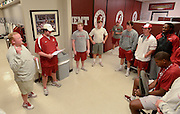 Equipment managers work in the Mal Moore Athletic Facility to get the University of Alabama football team ready for the trip to Baton Rouge to face LSU.  Assistant equipment manager Larry Waters, left, gives directions to the staff of student managers who do the bulk of the packing work.  Photo by Gary Cosby Jr.