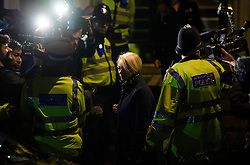 © Licensed to London News Pictures. 14/11/2016. London, UK. Swedish official INGRID ISGREN (blonde hair) leaves the Ecuadorian Embassy in London following the first day of questioning of WikiLeaks editor-in-chief, Julian Assange. Assange, who has been living at the embassy for over four years, is wanted for questioning over accusations of rape in Stockholm in 2010.  Photo credit: Ben Cawthra/LNP