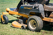 Yard Mowing safely means taking extra care with proper clothing. long pants, long sleeve shirts, gloves, leather boots, safety glasses, hearing protection, dust mask,