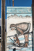 A painted wall mural of an eskimo hunting in downtown Anchorage, Alaska.