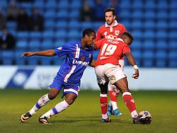 Gillingham's Gavin Hoyte fouls Bristol City's Kieran Agard - Photo mandatory by-line: Dougie Allward/JMP - Mobile: 07966 386802 - 08/11/2014 - SPORT - Football - Gillingham - Priestfield Stadium - Gillingham v Bristol City - FA Cup - Round One