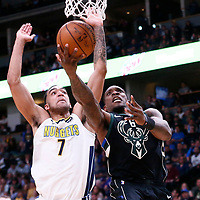 01 April 2018: Milwaukee Bucks guard Eric Bledsoe (6) goes for the layup past Denver Nuggets forward Trey Lyles (7) during the Denver Nuggets 128-125 victory over the Milwaukee Bucks, at the Pepsi Center, Denver, Colorado, USA.