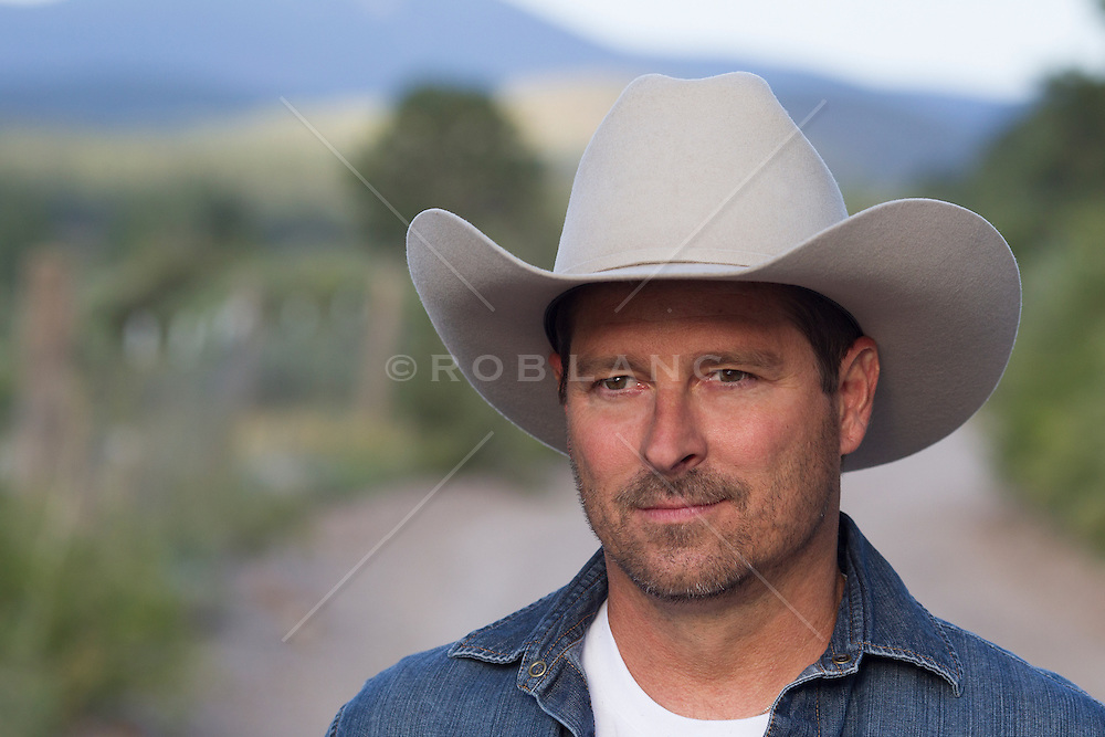 portrait of a handsome middle aged cowboy outdoors