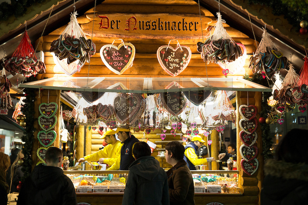 © Licensed to London News Pictures. 15/11/2014. Birmingham, West Midlands, UK. Thousands of people visited the Birmingham German Market during the first weekend of it's opening. The annual Christmas market, now in it's 14th year is the second largest German market in Europe. The German market is estimated to be worth 85 million pounds to the  Birmingham economy. The stalls which stretch right acorss the City Centre from Broad Street to the Bullring are now a mixture of German and local Brummie business's.Pictured, one of the many stalls selling nuts and chocolates on New Street. Photo credit : Dave Warren/LNP