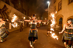 Members from fire group Pyroceltica kicked off Edinburgh's Hogmanay celebration's by leading off the annual torchlight procession down the Royal Mile.<br /> <br /> © Dave Johnston / EEm