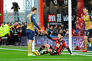 Arsenal defender Nacho Monreal helps AFC Bournemouth defender Adam Smith up during the Barclays Premier League match between Bournemouth and Arsenal at the Goldsands Stadium, Bournemouth, England on 7 February 2016. Photo by Graham Hunt.