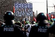 Frankfurt am Main | 18 Mar 2015<br /> <br /> Blockupy-Proteste in Frankfurt am 18.03.2015, hier: Demonstranten hinter einer Polizeikette mit einem Transparent mit der Aufschrift&quot;People Ove Banks&quot;.<br /> <br /> photo &copy; peter-juelich.com