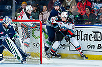 KELOWNA, BC - MARCH 6: Ethan Ernst #19 and Dillon Hamaliuk #22 of the Kelowna Rockets check Owen Williams #25 behind the net of Roddy Ross #1 of the Seattle Thunderbirds at Prospera Place on March 6, 2020 in Kelowna, Canada. (Photo by Marissa Baecker/Shoot the Breeze)