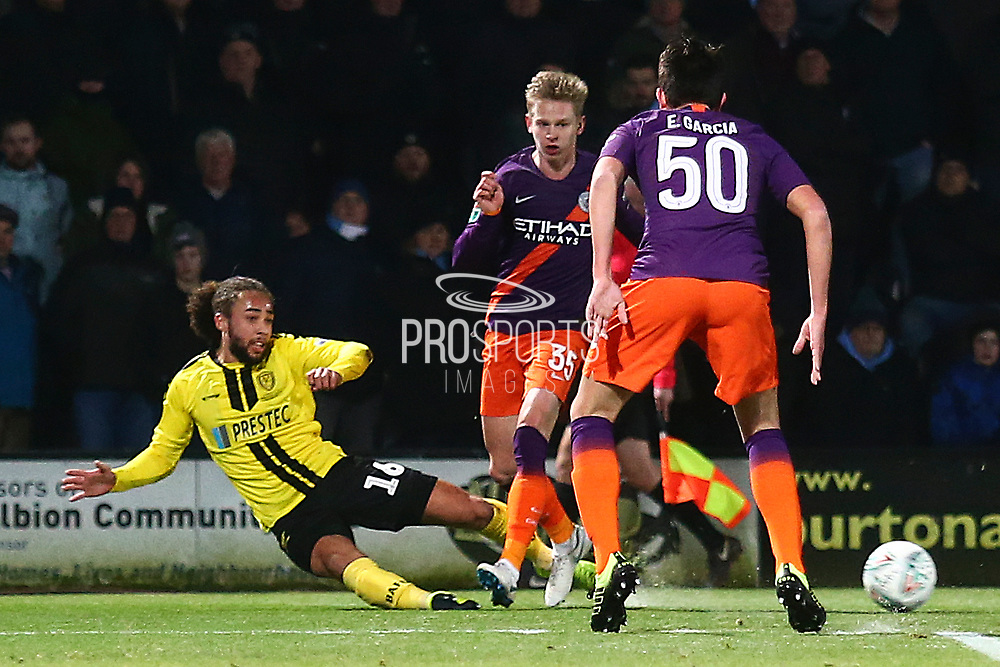 Burton Albion midfielder Marcus Harness (16) slides a pass during the EFL Cup semi final second leg match between Burton Albion and Manchester City at the Pirelli Stadium, Burton upon Trent, England on 23 January 2019.