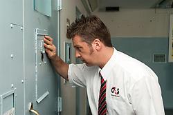 Prison Officer checks prisoners in UK prison