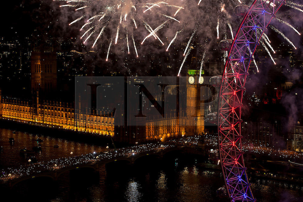 © Licensed to London News Pictures. FILE PICTURE DATED 01/01/2013. London, UK. A spectacular fireworks display lights up the London skyline just after midnight on January 1, 2013 in central London as part of the capitals New Year's Eve celebrations. Thousands of people lined the banks of the River Thames in London to see in the New Year. Photo credit: Ben Cawthra/LNP.