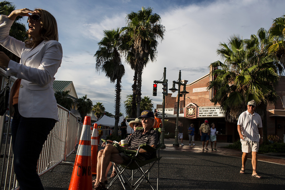 Gwen and Terry Rutter, center, wait for the start of a campaign rally with Republican Vice Presidential candidate  Rep. Paul Ryan (R-WI) on Saturday, August 18, 2012 in The Villages, FL.