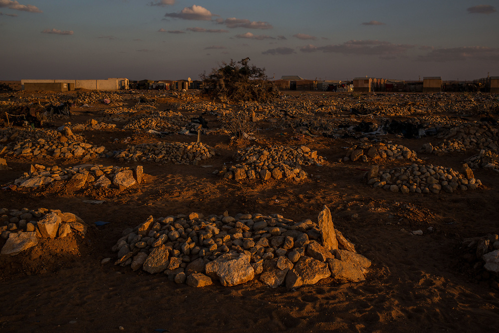 Recently dug graves sit at the edges of a cemetery at the Shabelle IDP camp on February 26, 2017 in Garowe, Somalia. The camp had seen an reported 20 deaths from a water born illness in the past two weeks.