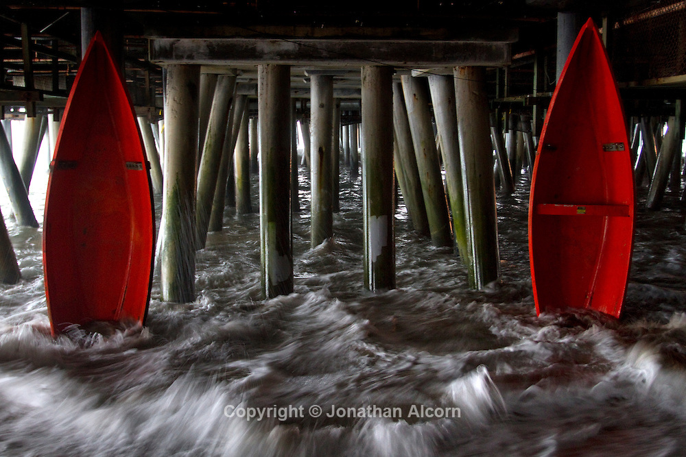 An art display of red boats under the Santa Monica Pier in Santa Monica, California
