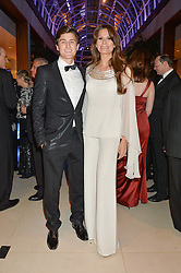 ISABELL KRISTENSEN and her son MARTIN KRISTENSEN at Steps To The Future -in aid of RAFT (Restoration of Appearance & Function Trust) and Walking With The Wounded held at The Hurlingham Club, London on 28th November 2014.